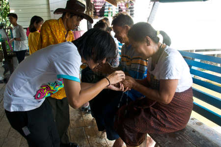 THAILAND - APRIL  Thai people celebrating Songkran (Thai new year  water fest.) bring flower garlands to their respected senior at Bangkok