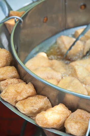 Fried  tofu with sauce is traditional chinese snacks. photo