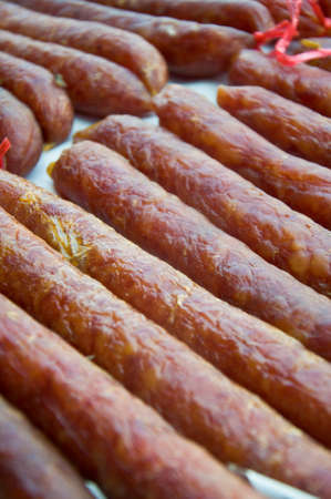 long Chinese Sausages uncooked in thai  market photo