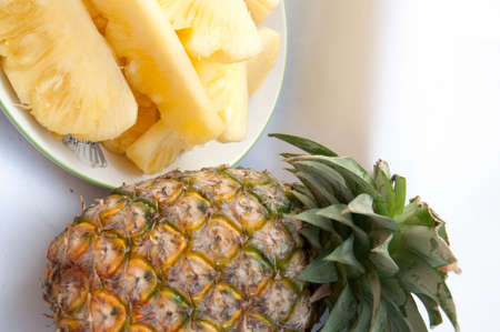 Dish with slices of pineapple on a white background  photo
