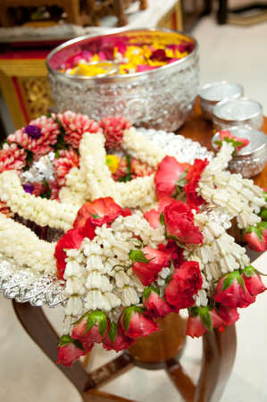 Garlands on table  preparing for respectfully pouring water to elderly on Songkran Festival (Water Festival) in Thailand. Stock Photo