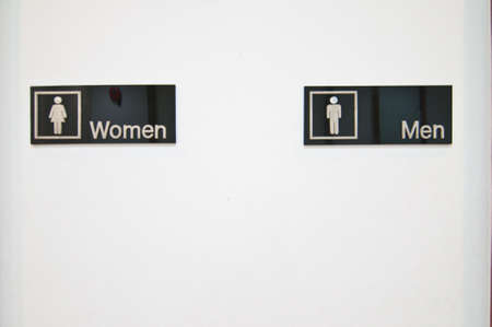 Sign of public toilets one white wall Stock Photo - 13425573