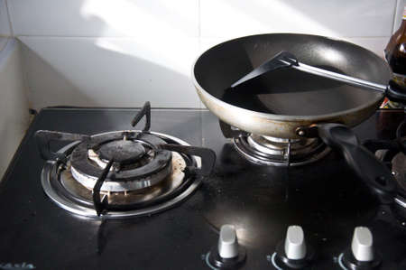 Empty gas stove and pan for cooking in the kitchen photo