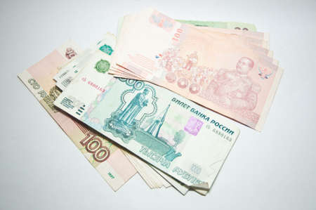 Russian rubles banknotes and Thai bath Stock Photo - 13475380