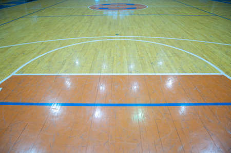 Wooden basketball court. Indoor sports playground