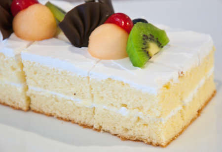 A piece of vanilla cake with fruit photo