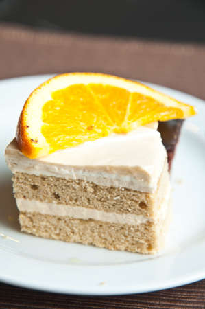 vanilla cake  and slice of orance Stock Photo - 13749588