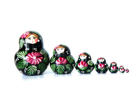 matroshka: russian nesting dolls  on white background
