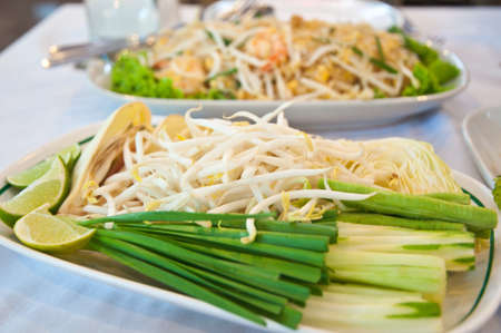 close up bean sprouts and lemon ready for eat photo