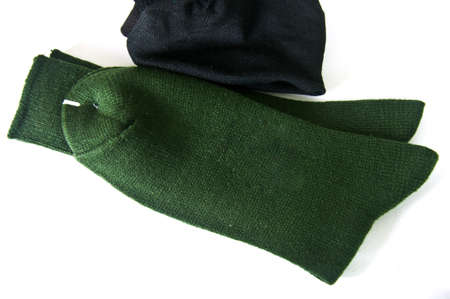 close up of men  green and black socks on white background photo