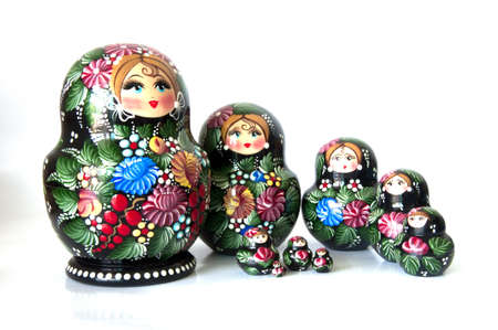 Family of Russian nested dolls isolated on white photo