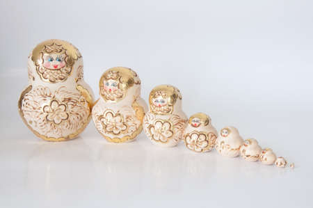 Matryoshka, a Russian wooden doll on a white background photo
