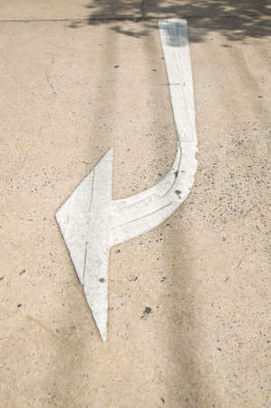 Arrow on a street at dawn photo