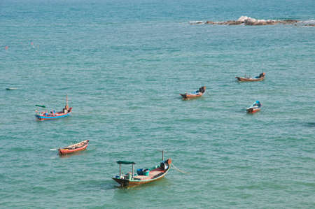 Traditional wooden boats for fishing in Thailand photo