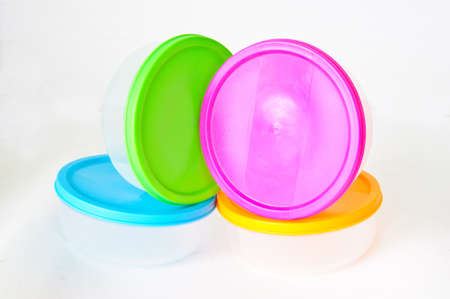 Colourful plastic containers isolated on a white background photo