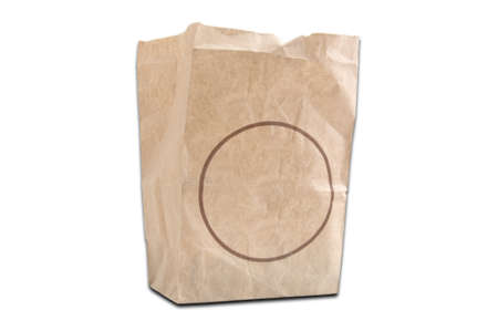 A brown kraft paper bag or sack with copy space on a white background photo