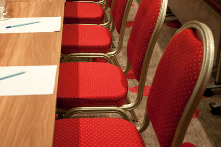 red metallic chairs of a conference room Stock Photo