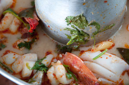 Thai spicy soup Tomyam in hot pot photo