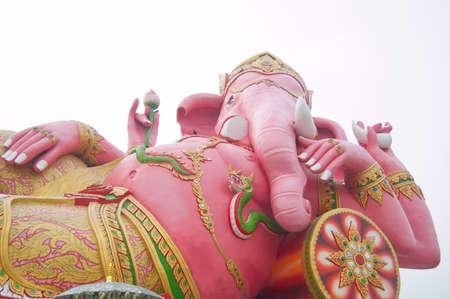 siddhivinayaka: Pink ganecha in relaxing protrait on white sky,Wat Samarn, Chachoengsao,Thailand