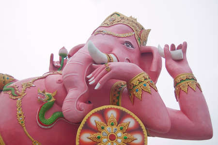 Pink ganecha statue in relaxing at Wat Samarn, Chachoengsao, Thailand photo