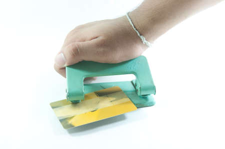 puncher: Hole puncher with credit card  in front of a white background
