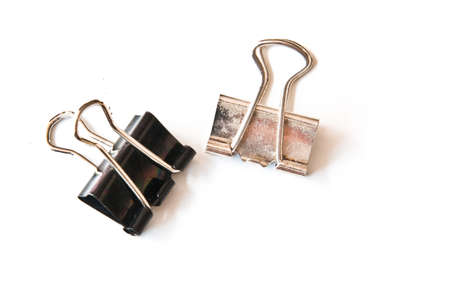 bowing: two small binder clips bowing to two large binder clips Stock Photo