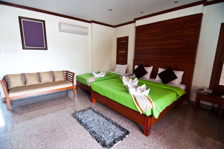 Green bedroom ready for guests green blanket Stock Photo - 19573408