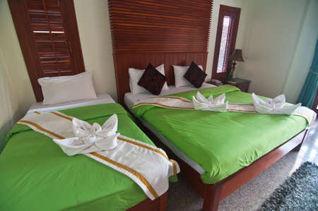 Beautiful double bed in traditional Thai setting Stock Photo - 19573410