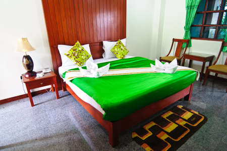 Green bedroom ready for guests green blanket Stock Photo - 19573405