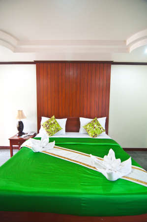 Green bedroom ready for guests green blanket Stock Photo - 19573388