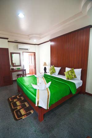 Asian style hotel room - green bedroom Stock Photo - 19573401