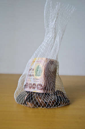 Bag,Thailand Banknote and coins