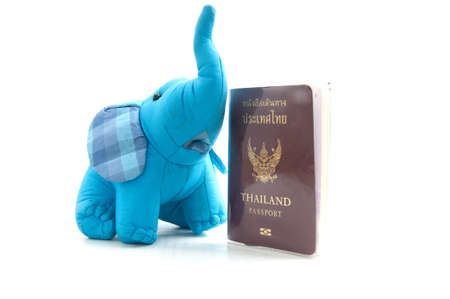 Thailand passport and silk elephant -souvenir from Thailand photo