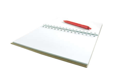 red pen on notebook on white photo