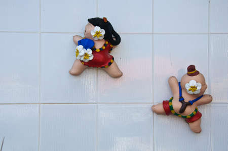 gril: The little boy and gril statue with slingshot to fun and happy-Thai