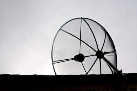 parabolic mirror: Telecommunication concept. Old satellite antenna - bad communication