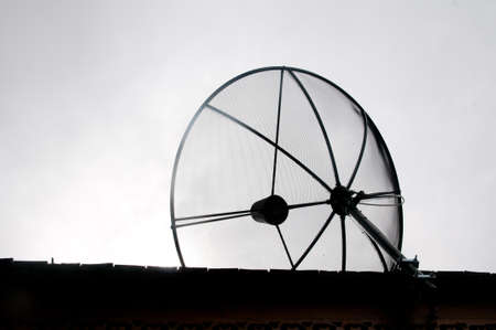 Telecommunication concept. Old satellite antenna - bad communication photo