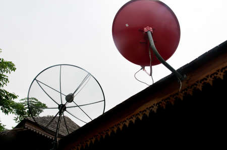 Two Satellite dish on roof photo