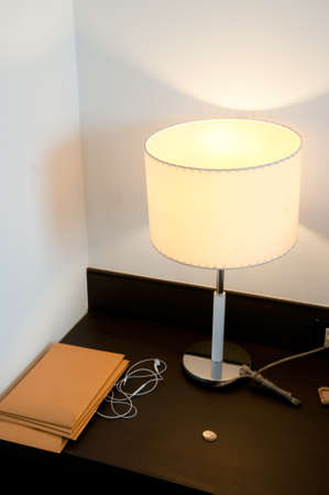 shining lamp on the table near bed Stock Photo - 22545465