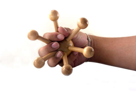 corporal: Wood object for corporal massage in hand