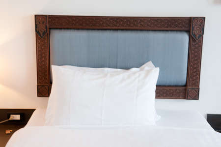 White pillows on a bed Comfortable soft pillows on the bed Stock Photo - 22545590