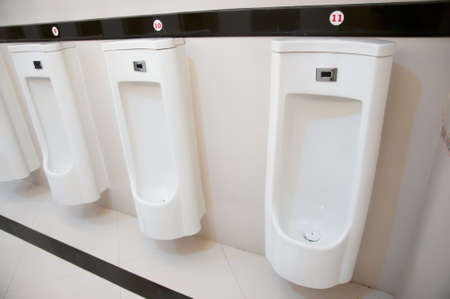 modern restroom inter with urinal row Stock Photo - 22545597