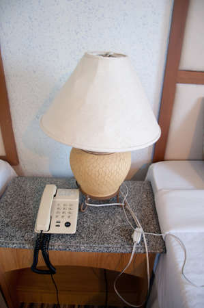 Close Up Fragment Of The Bedroom With Reading Lamp And Phone Stock Photo - 22680250