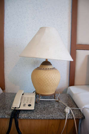 Close Up Fragment Of The Bedroom With Reading Lamp And Phone Stock Photo - 22680255