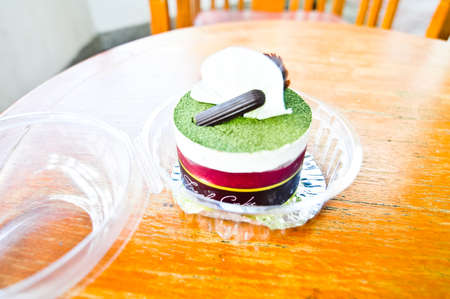 Delicious cake! Fresh and healthy! green tea on wood photo
