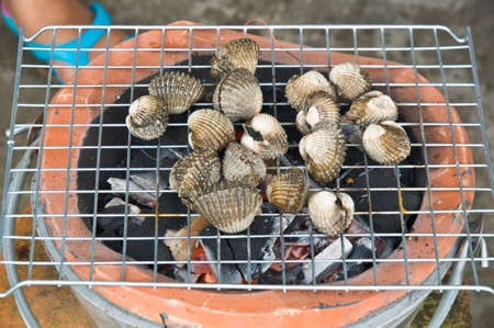cockles: Cockles on flaming grill