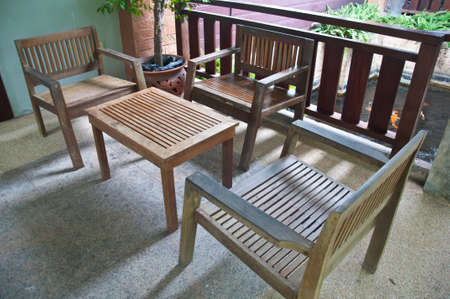 The wood furniture by the house patio photo