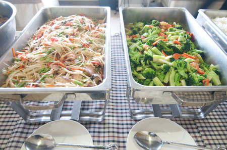 Thailand food buffet -papaya salad and stir-fried vegetables photo
