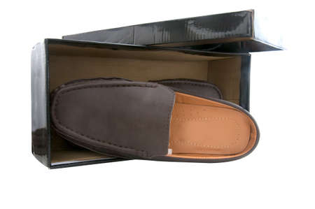 Pair of brown male shoes in front of sale box on white photo