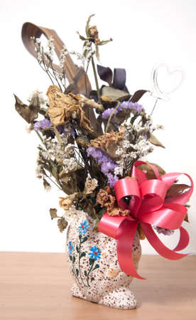 Bouquet of withered flower in vase photo